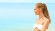 Woman in white bikini relaxing on the beach in daylight