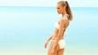 Happy smiling woman in bikini enjoy her time at the beach