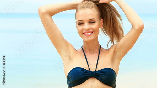 Portrait of happy woman enjoying the summer time at exotic beach