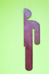 Sign of public toilets for men on green wall