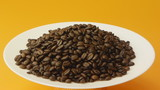 coffee beans on a white plate