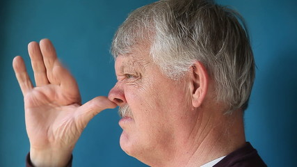 man thumbing nose