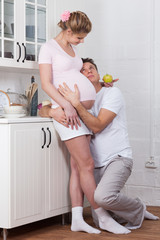 Happy pregnant family