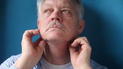 man checking his painful lymph nodes
