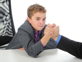 boy and a man arm wrestling