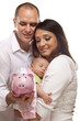 Young Mixed Race Parents with Baby Holding Piggy Bank