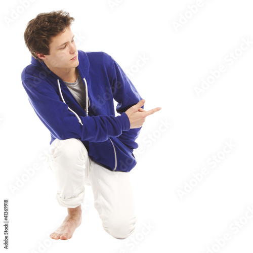 Barefoot handsome man kneeling down