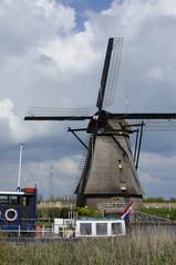 windmill and boat, kinderdijk, netherlands