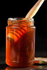 Honey full jar with a honey dipper