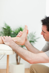 Close up of a physiotherapist massaging a foot