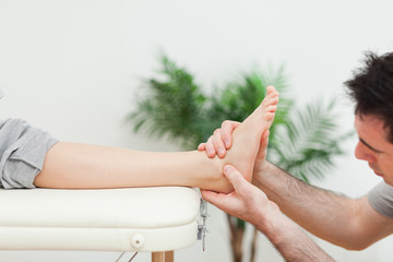 Close-up of a doctor massaging a foot