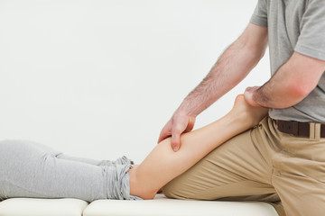 Close-up of a woman lying while being massaged