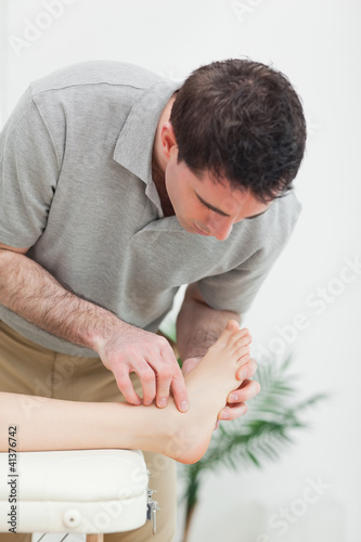 Podiatrist examining the foot of a patient
