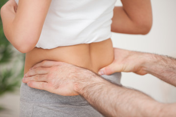 Close-up of a man touching the hips of a woman