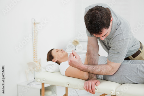 Physiotherapist massaging the pelvis of a woman