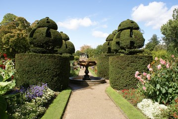 path, fountain, & yew topiary