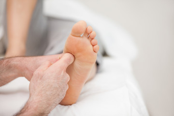 The side of a foot being massaged