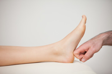 Forefinger touching a barefoot