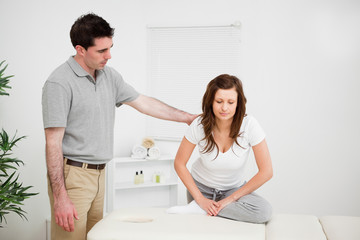 Peaceful woman doing stretching exercises with a doctor