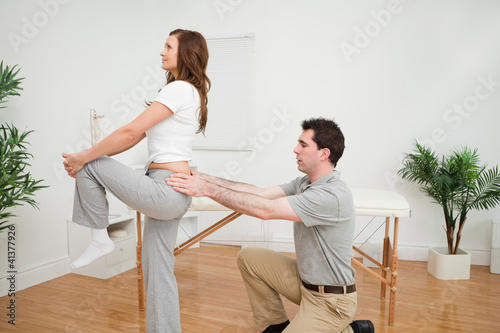 Serious woman stretching her leg