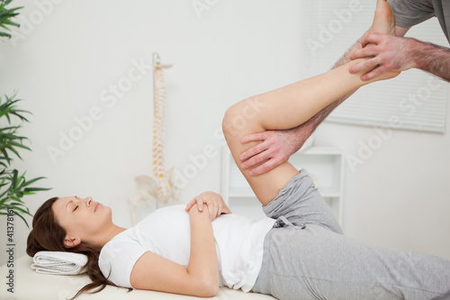 Serious brunette woman lying on a medical table