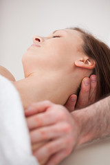 Close-up of neck of woman beig manipulating by a therapist