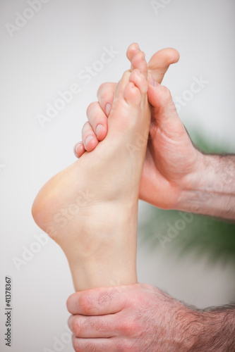 Doctor massaging the foot of his patient