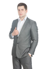 Picture of a young businessman in a gray suit over white