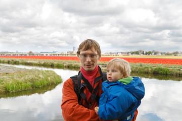 family  in spring flower fields
