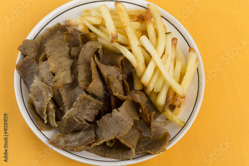 Donner Meat & Chips on a yellow / orange background