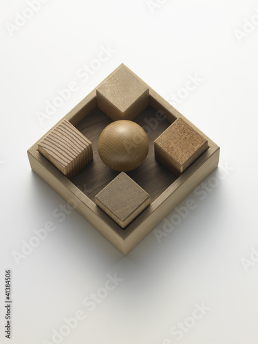 cubes and wooden ball in a box cubi e sfera di legno in scatola