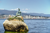 A girl sitting on a rock in Vancouver BC.