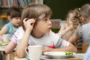 Little boy has a lunch