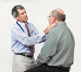 Doctor Examining Senior Patient's Swollen Glands