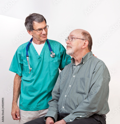 Doctor or Nurse Comforting Senior Male Patient