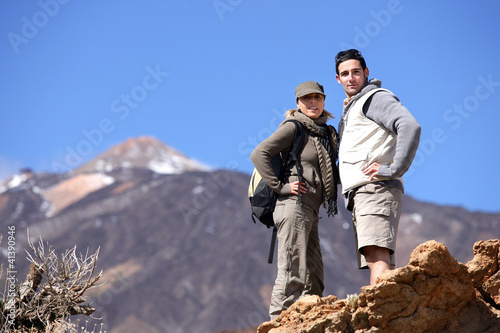 Couple hiking through the mountains