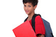 Schoolboy with folder and backpack