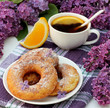 Sweet donuts and tea with orange