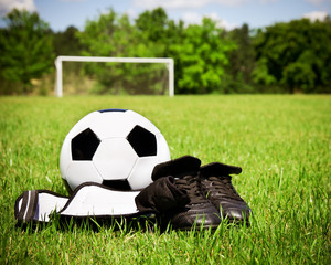 Child soccer or football gear on field