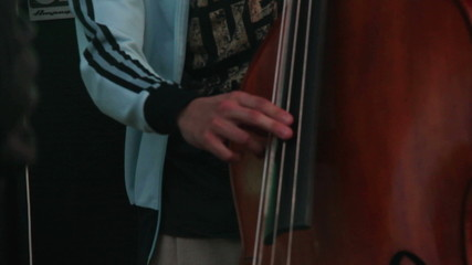 Musician playing on a contrabass