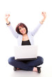 Happy cheering woman on laptop with elegant look