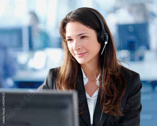 Woman with headset in the office