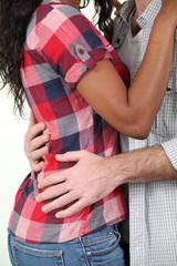 Mixed race couple hugging