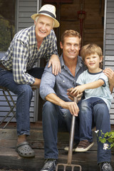 Father, son and grandson on veranda