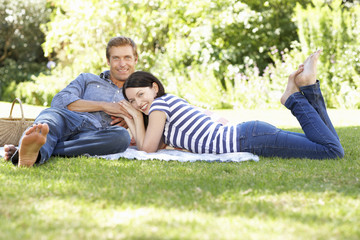 Couple relaxing in park