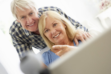 Senior couple using skype