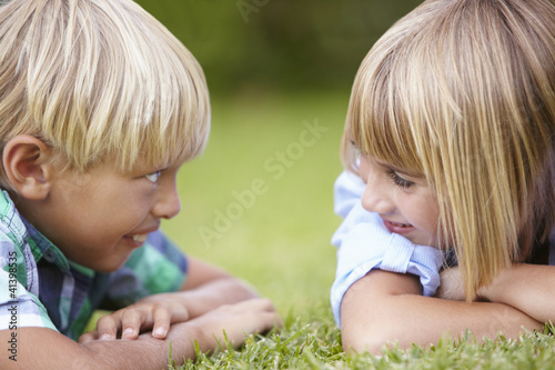 Young boy and girl outdoors