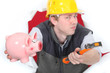 Builder with hammer and piggy-bank