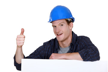 Builder with his thumb up