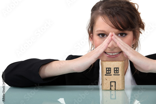 Woman with miniature model house